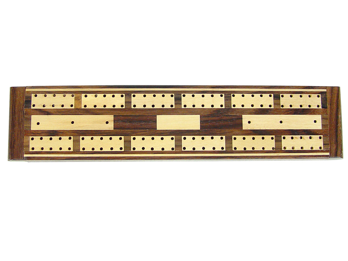Close-up view of cribbage board without wooden pegs