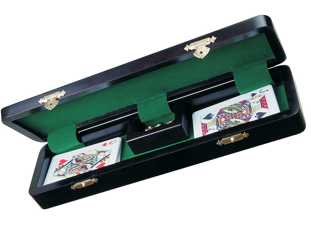 Opened cribbage board with playing cards and pegs with 6 pegs