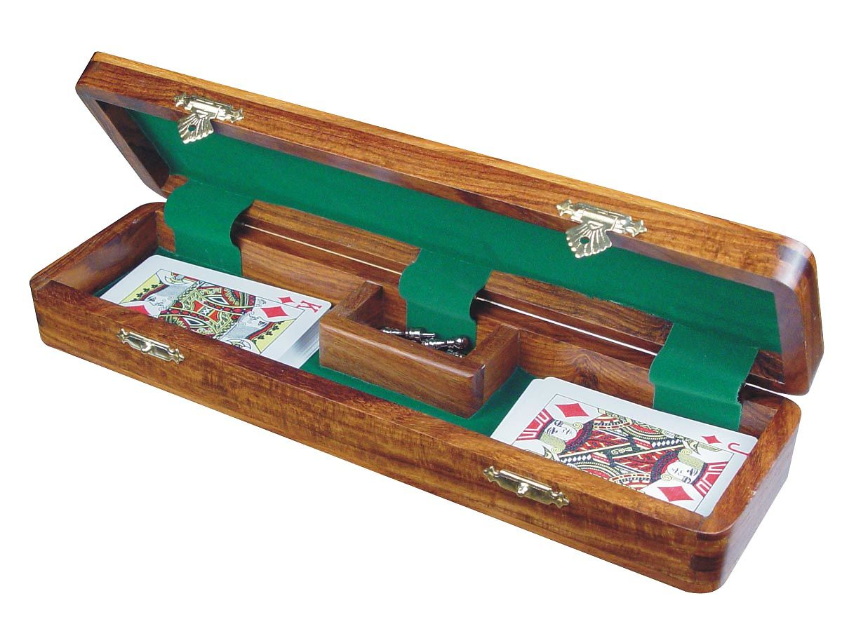 Opened cribbage board with Playing Cards and Pegs
