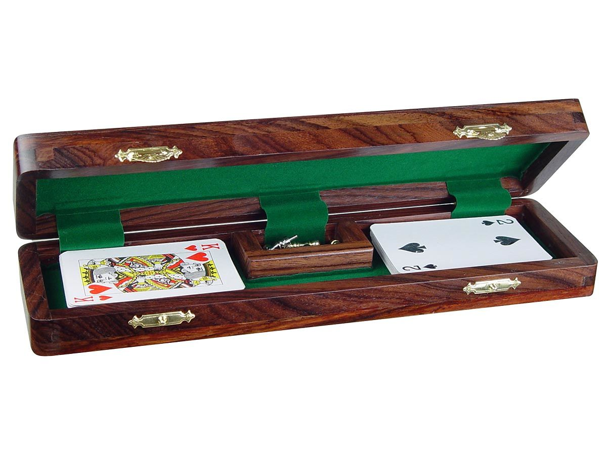 Inner view of cribbage board with pegs and playing cards