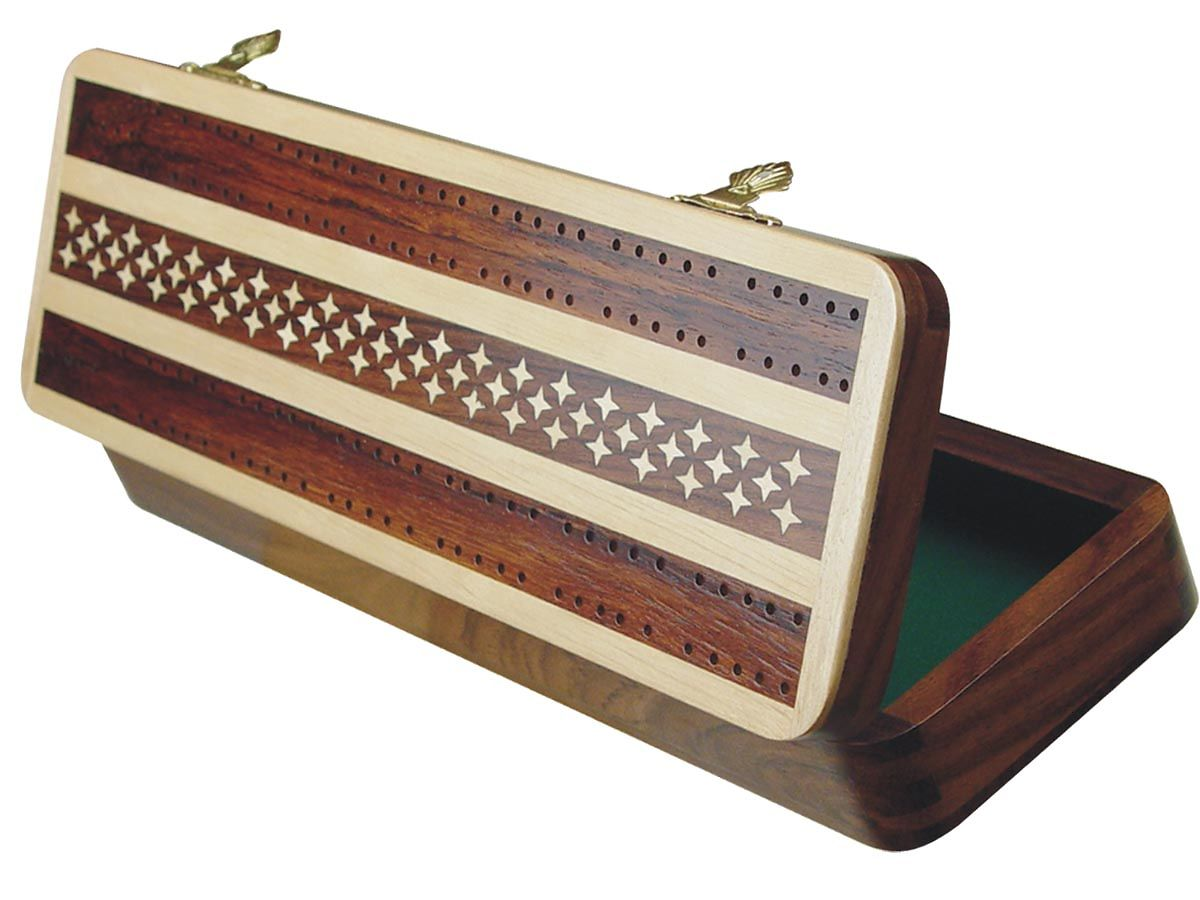 Inner view of cribbage board with metal pegs and playing cards inside