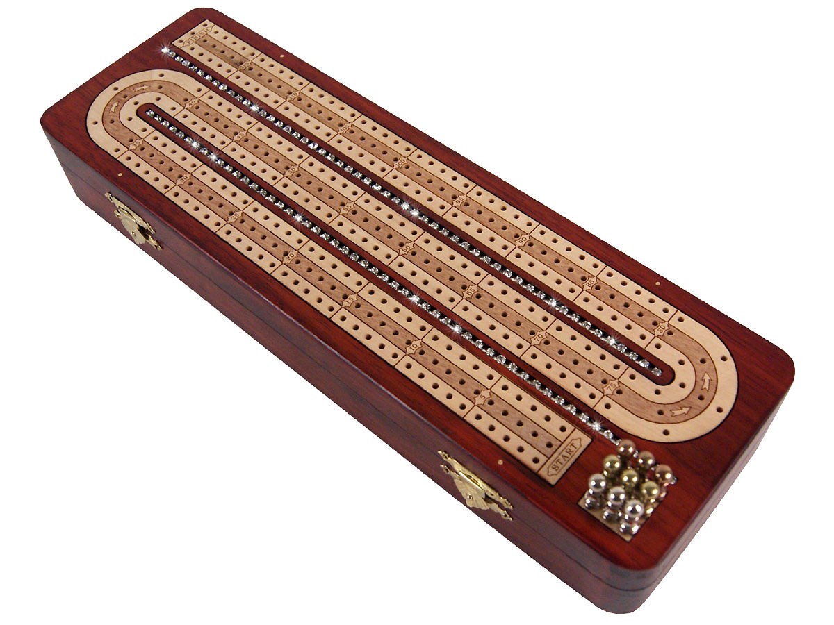 Side view of crystal studded bloodwood cribbage board with pegs