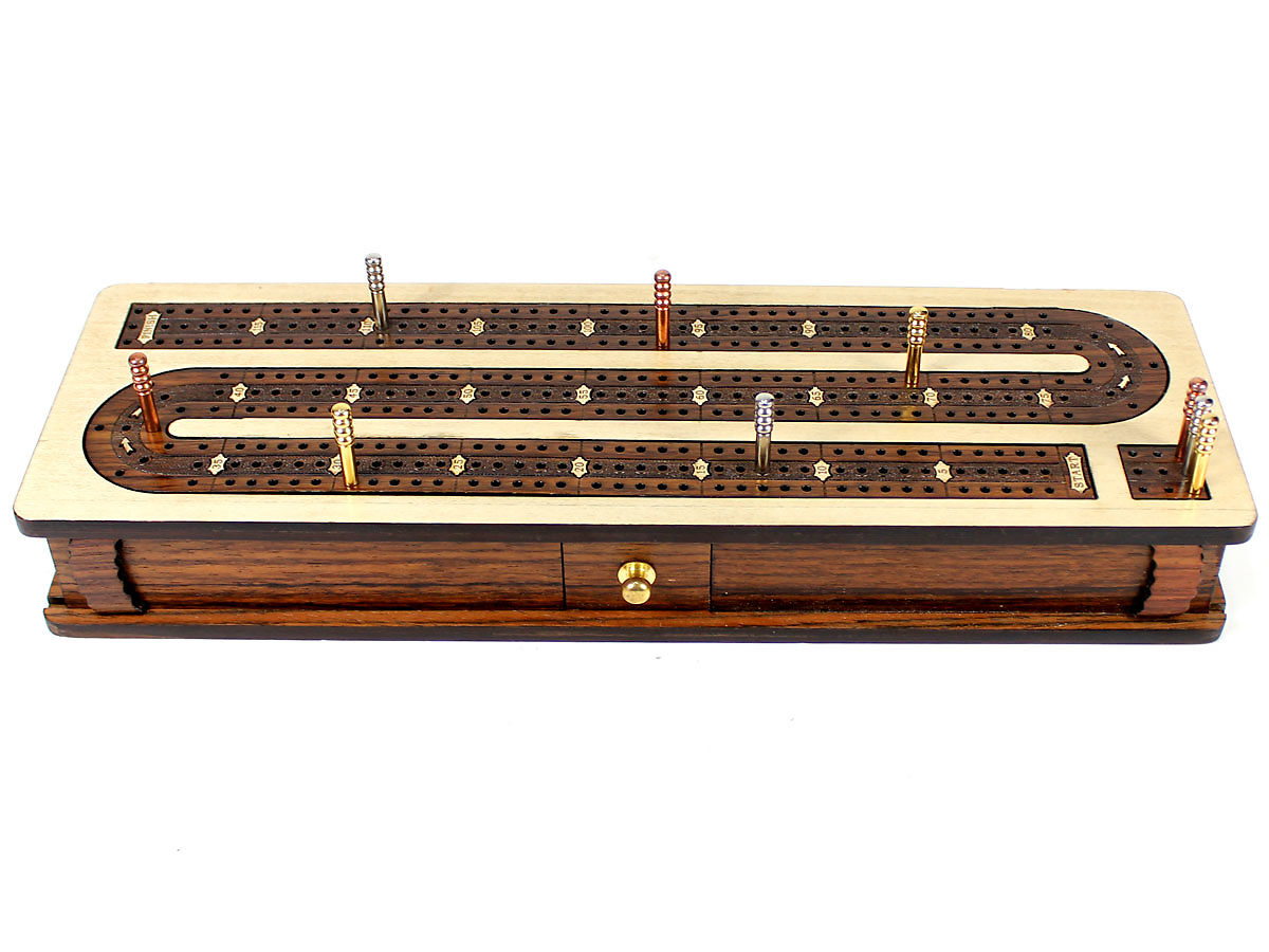 Front view of cribbage board with sliding lids and drawer closed