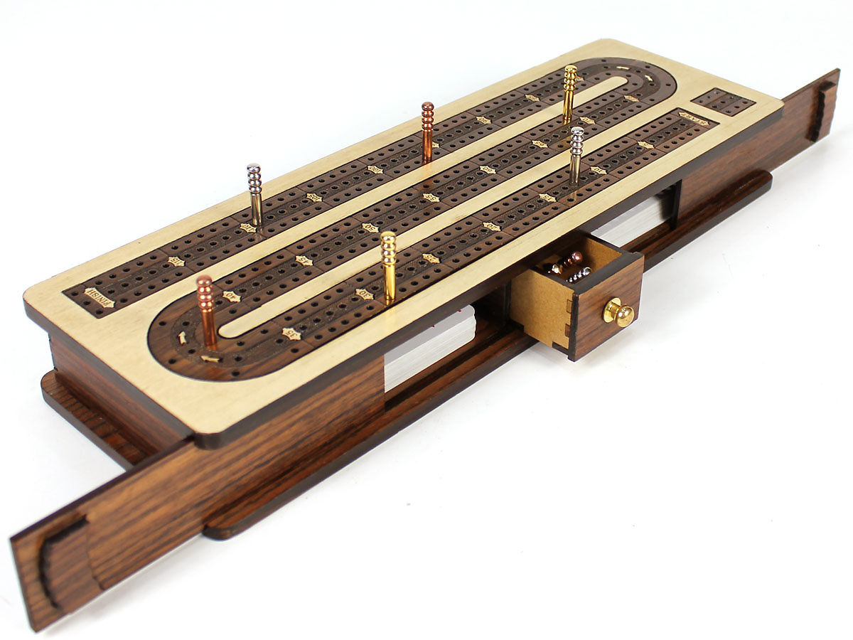 Side view of cribbage board with open lids and drawer