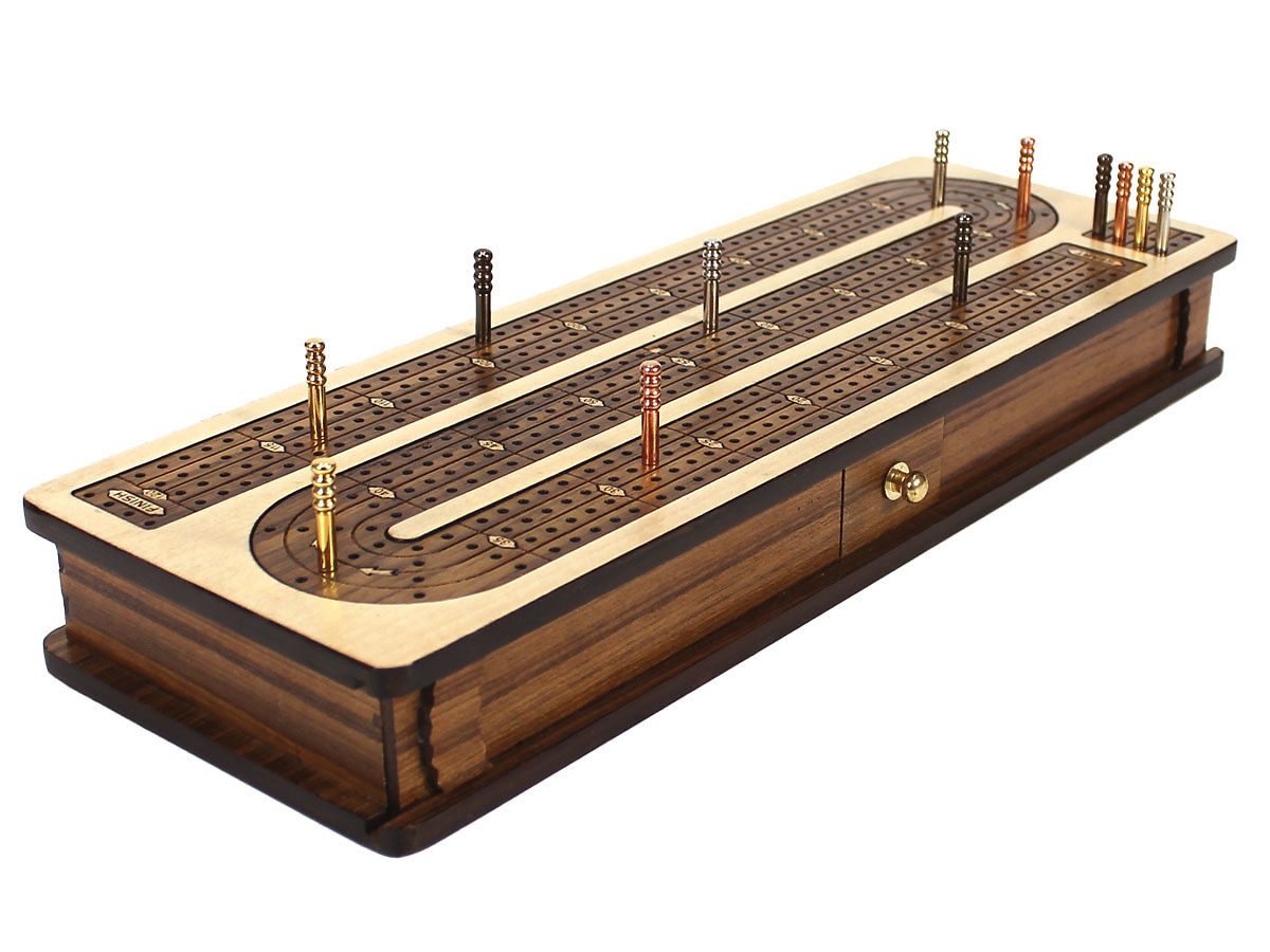 Side view of cribbage board with pegs on board
