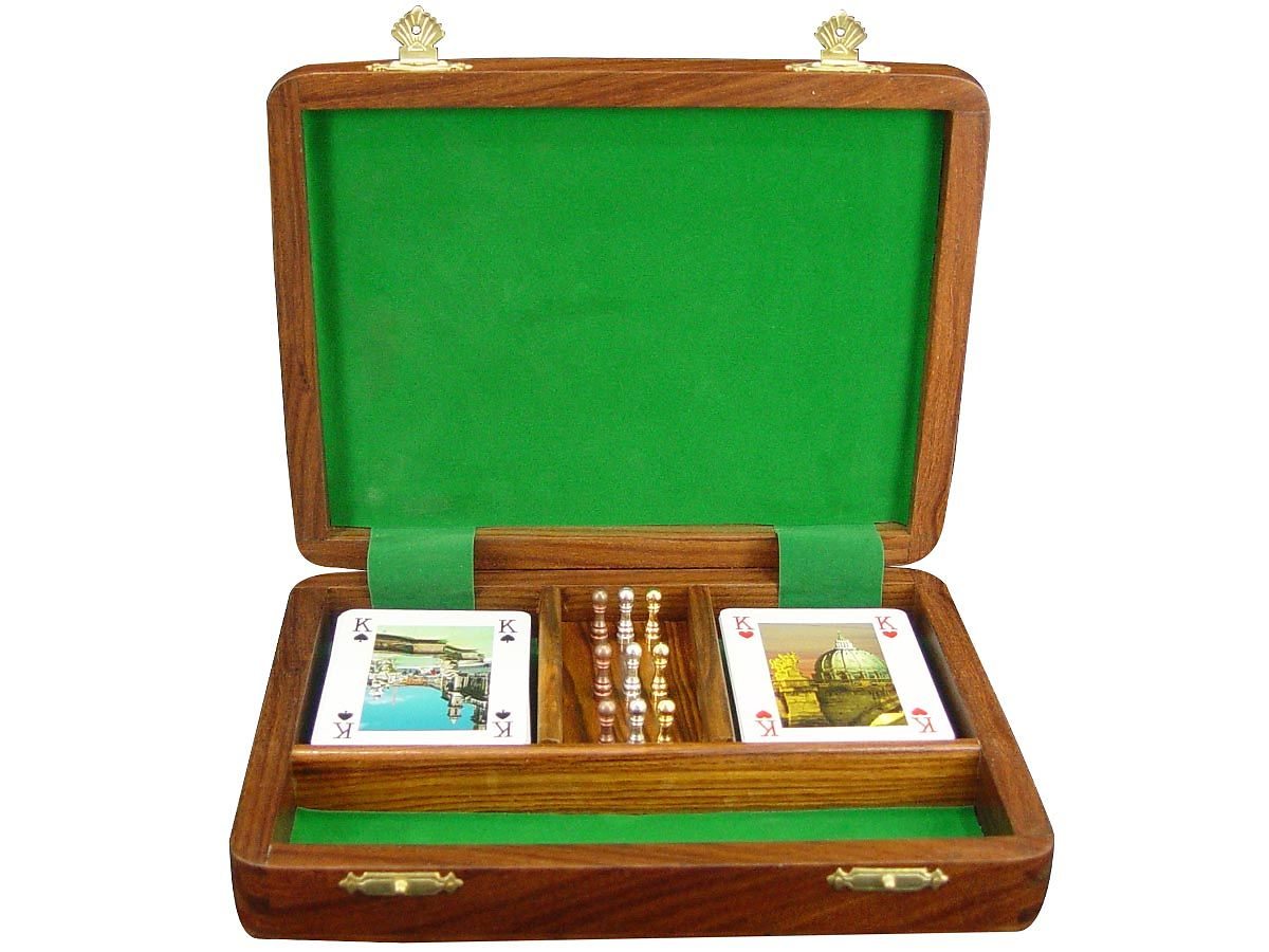Wooden Cribbage box inner view with playing cards and pegs