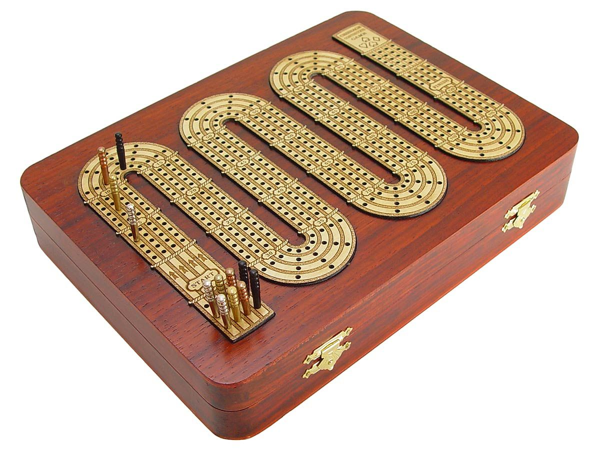 Front view of cribbage board with box closed and pegs standing on their place