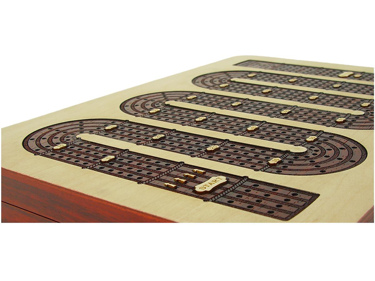 Cut out of inlaid tracks in bloodwood showing actual wood carving and no screen prints