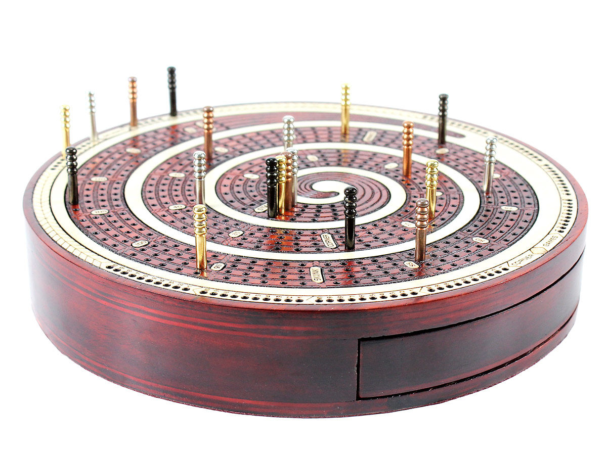 Round Cribbage Board with drawers closed and pegs on top