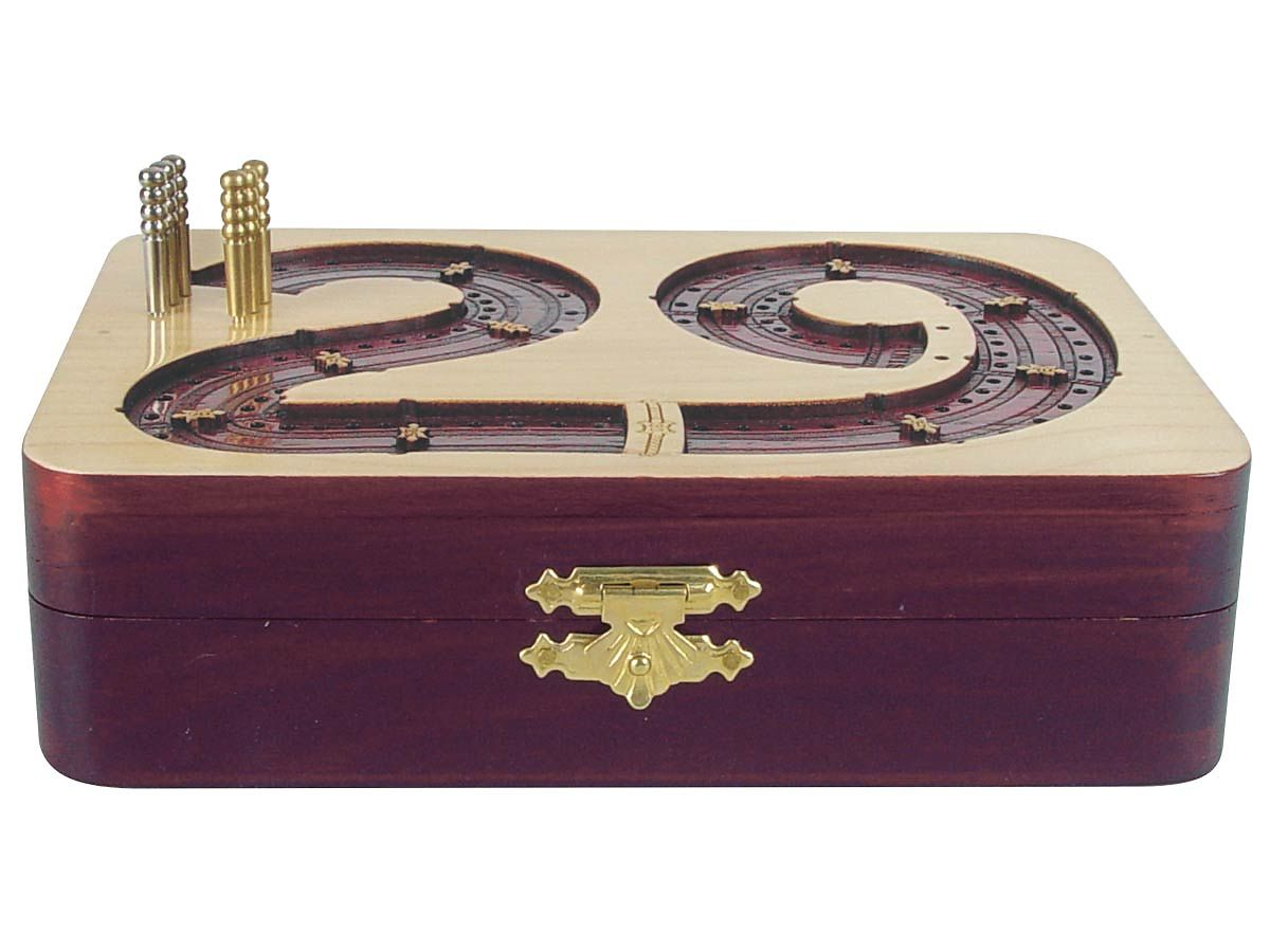 Front view of cribbage board with box closed and pegs standing on tracks