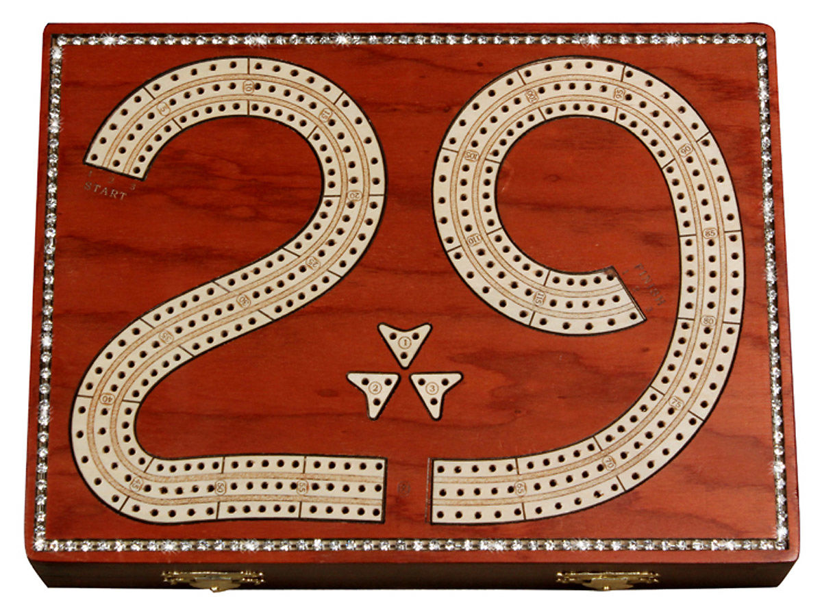 Top view of 29 cribbage board with crystal inlaid on bloodwood board