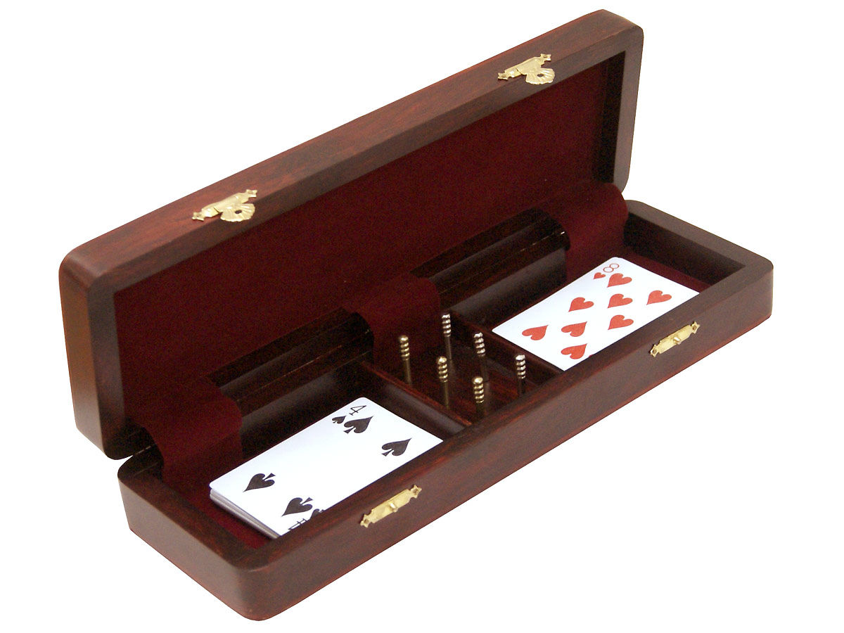 Inner view cribbage box with playing cards and pegs