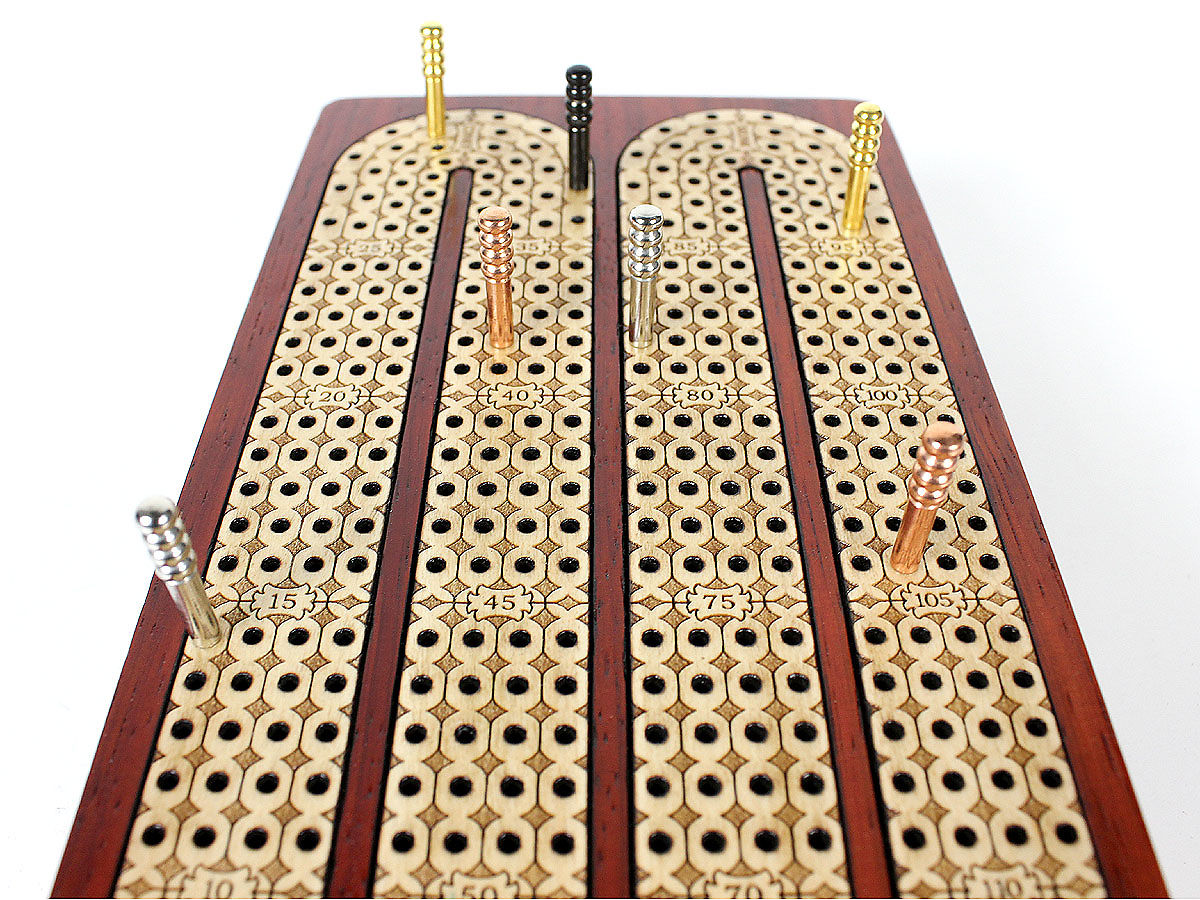 Close up view of cribbage board with inlaid maple tracks and design
