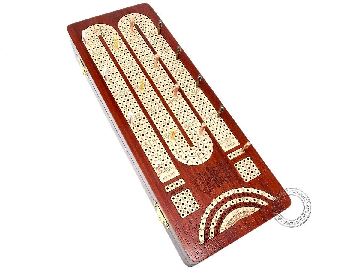 Top view of cribbage board with metal pegs