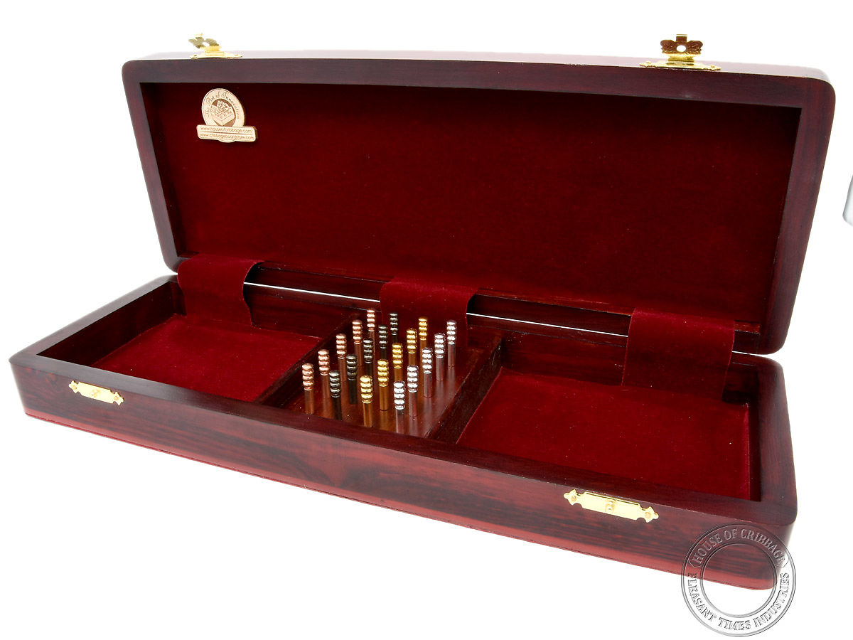 Inner view of hinged box with 2 compartments for playing card storage and 1 for pegs