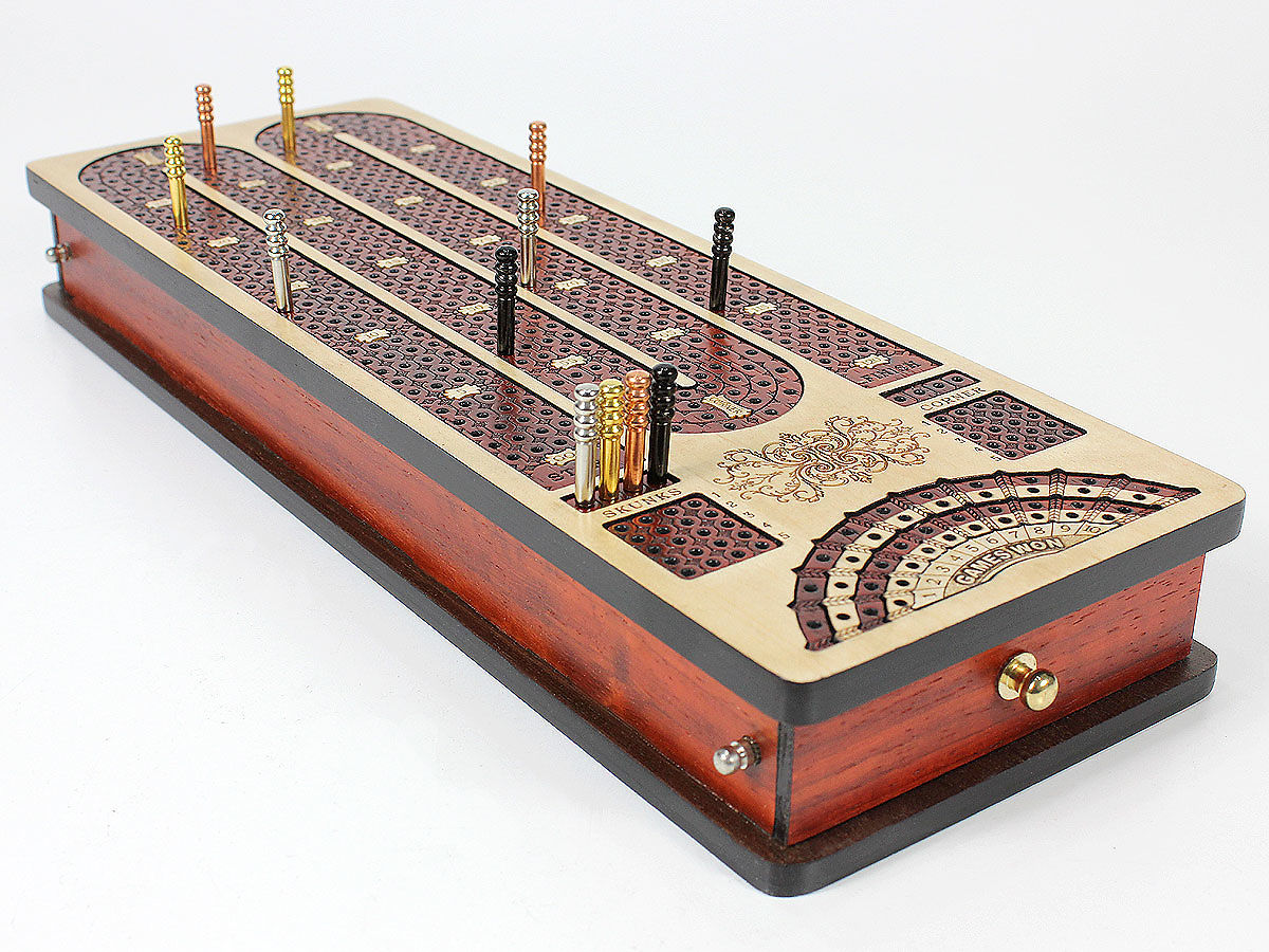 Side view of continuous cribbage board - drawers closed