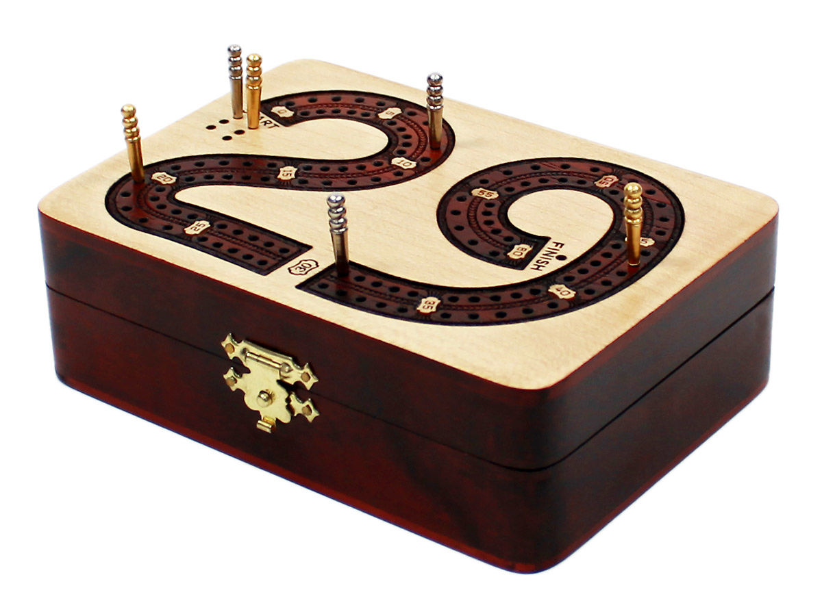 Side view of 29 digits shape cribbage board with pegs on tracks