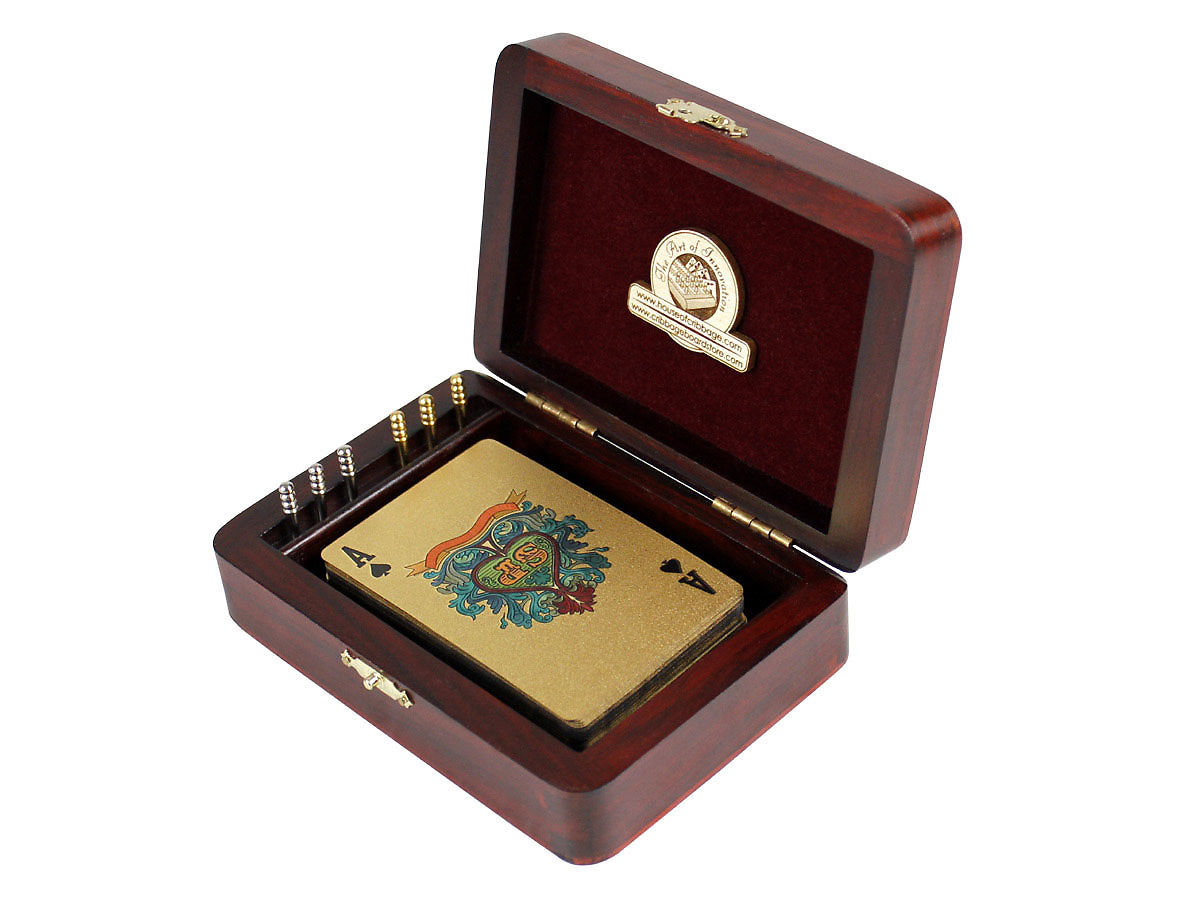 Inner view of cribbage box with playing cards and pegs