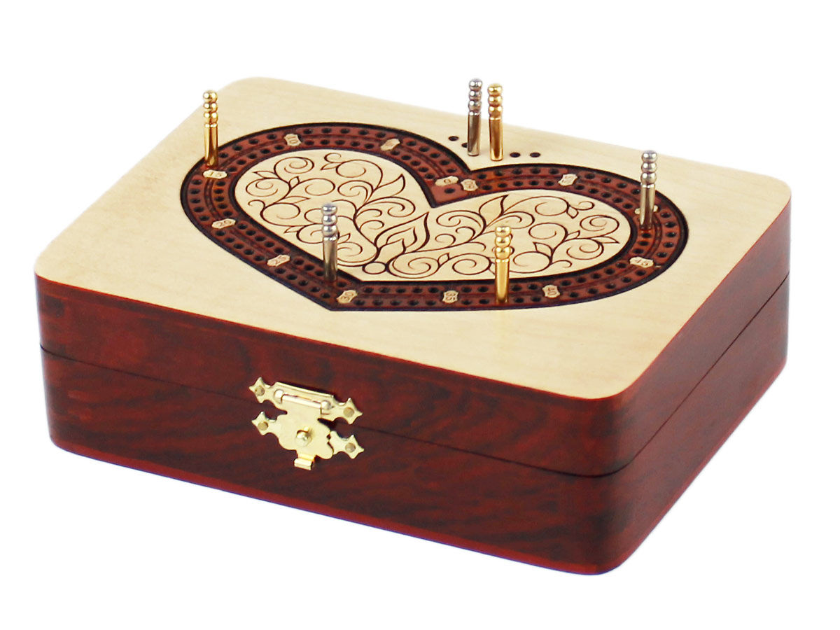 Side view of heart shape cribbage board with pegs on tracks