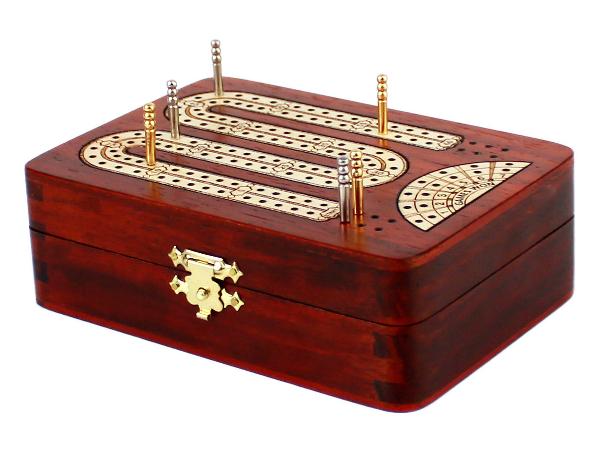 Side view of cribbage board with pegs on tracks