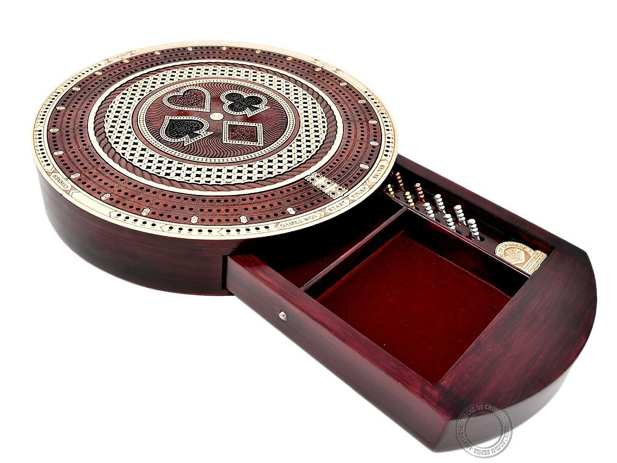 Side view of Round shape cribbage board with playing cards symbol and push drawer