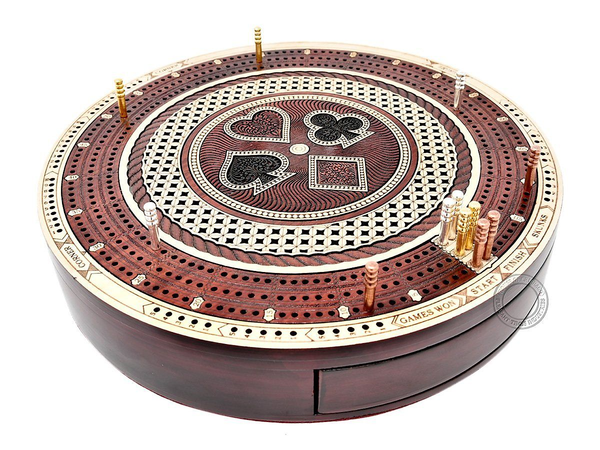 Close up view of Round shape cribbage board with playing cards symbol and drawer