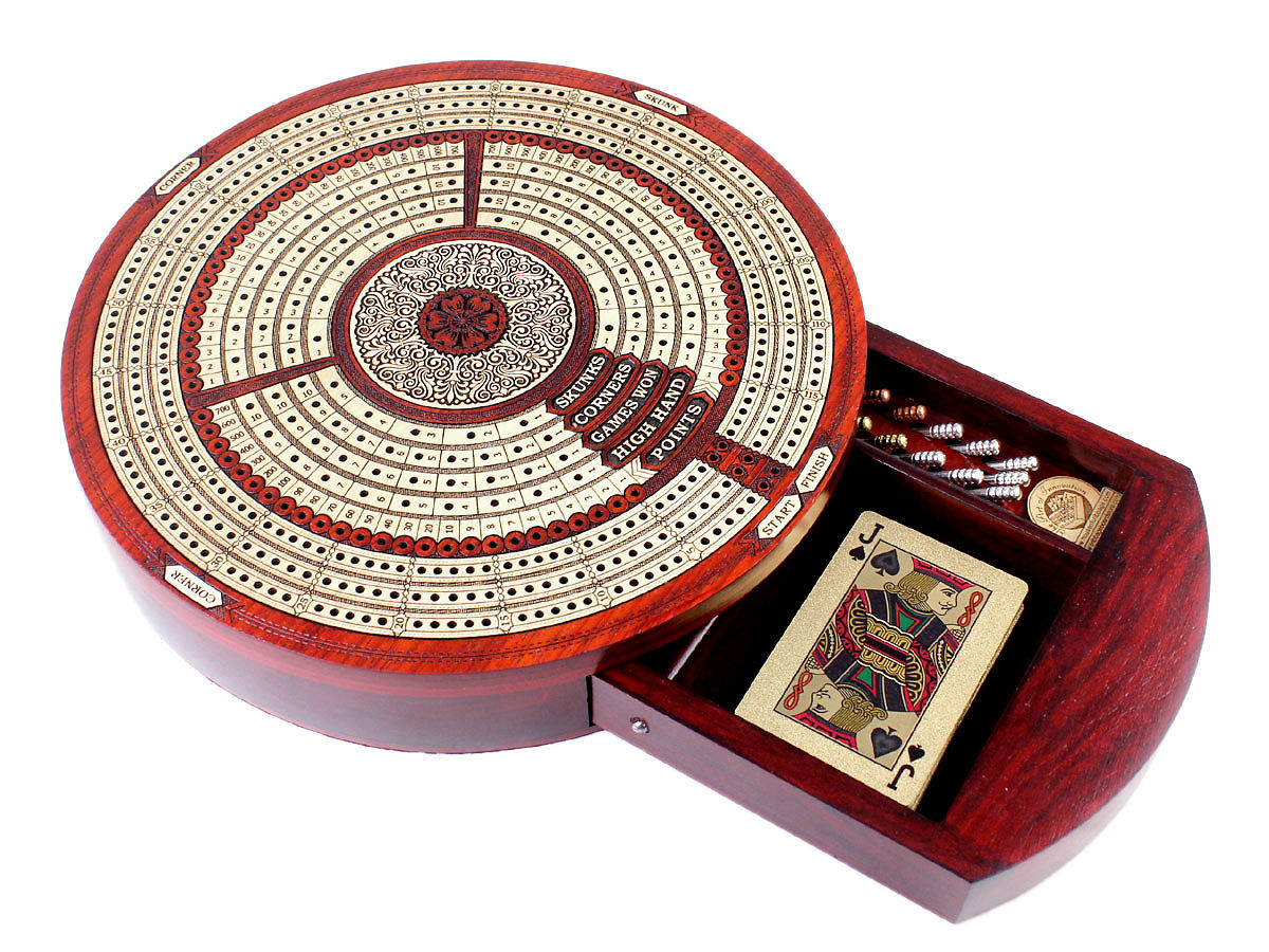 Side view of cribbage board with pegs and cards in drawer