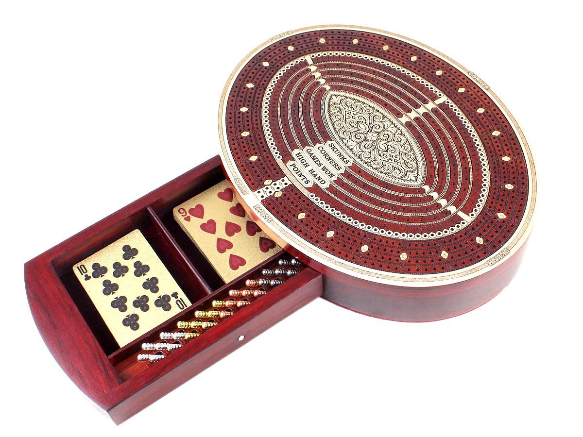 Cribbage board with storage drawer for cards and pegs