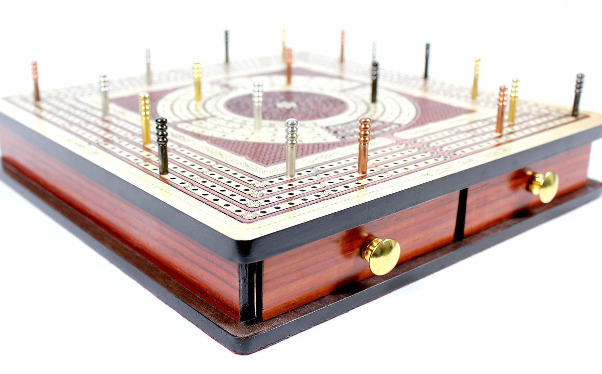 Side view of cribbage board with pegs