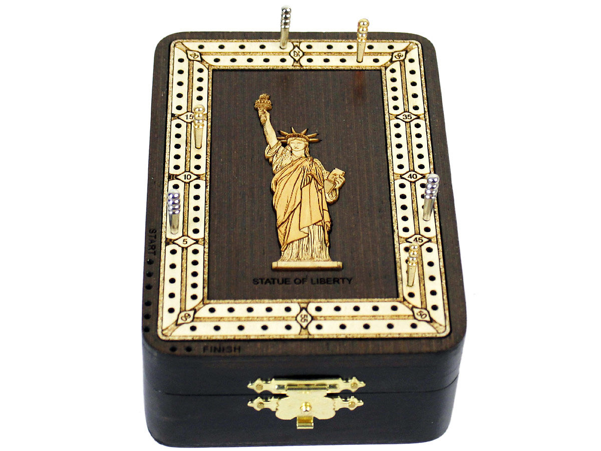 Front view of Statue of Liberty image inlaid board with tracks